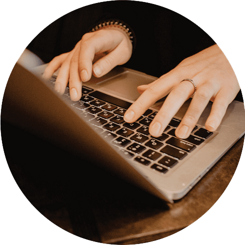 hand on a laptop